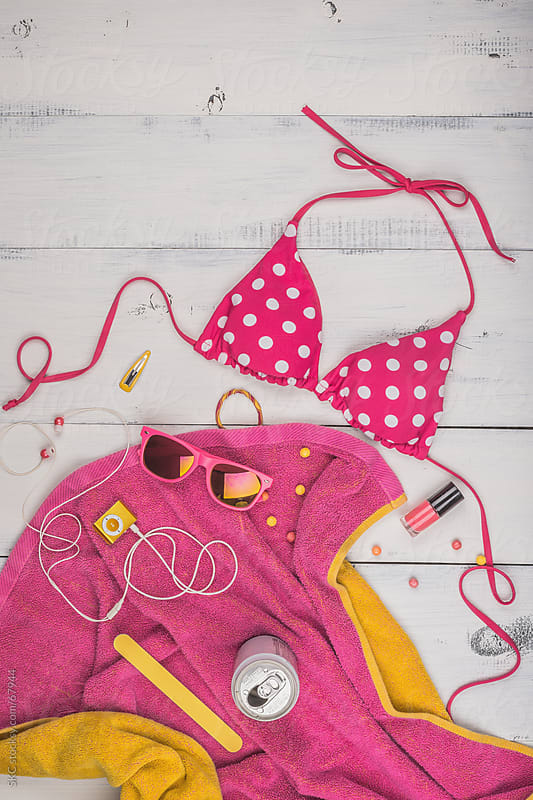 Summer Fun at the Water with Swimsuit and Beach Towel by suzanne clements for Stocksy United