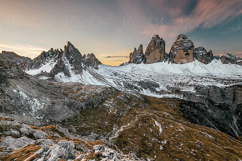 colorful sunrise above the famous three pinnacles in the italian alps by Leander Nardin for Stocksy United