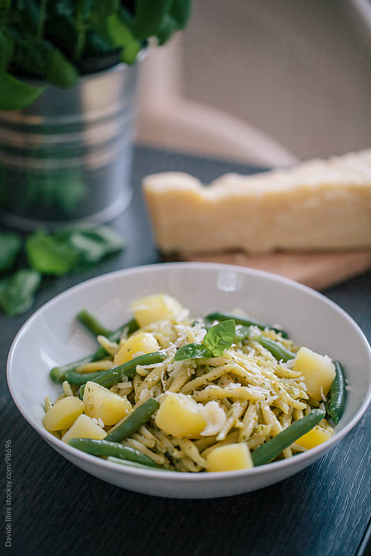 Pasta with pesto sauce potatoes and green beans. by Davide Illini for Stocksy United