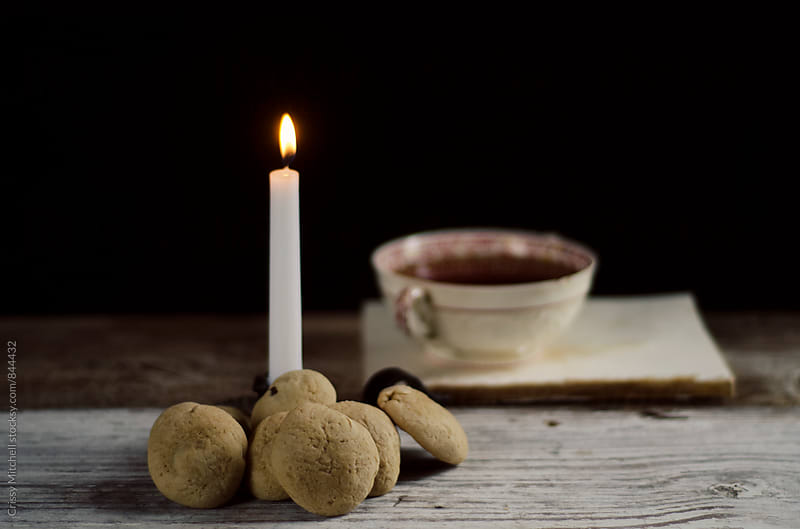 cookies and candle light by Crissy Mitchell for Stocksy United