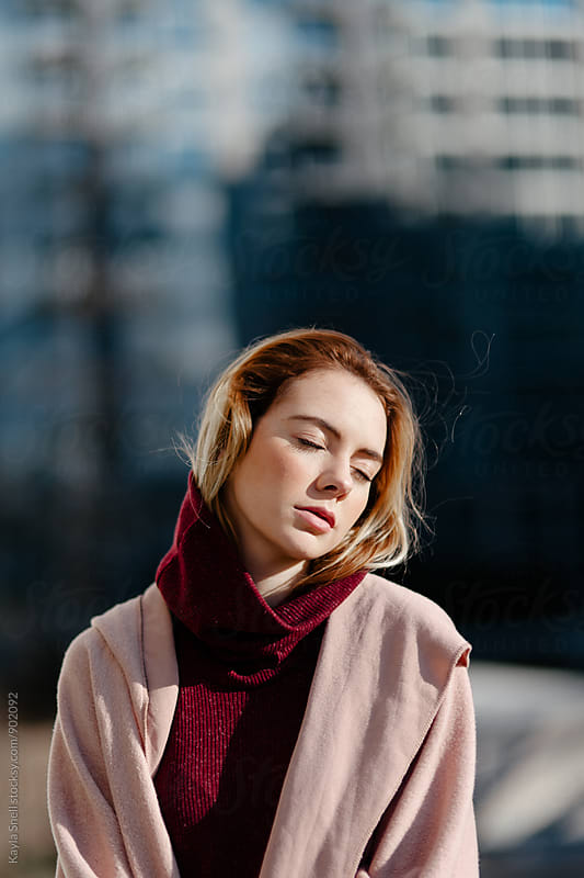 Young woman in bright sunlight by Kayla Snell for Stocksy United