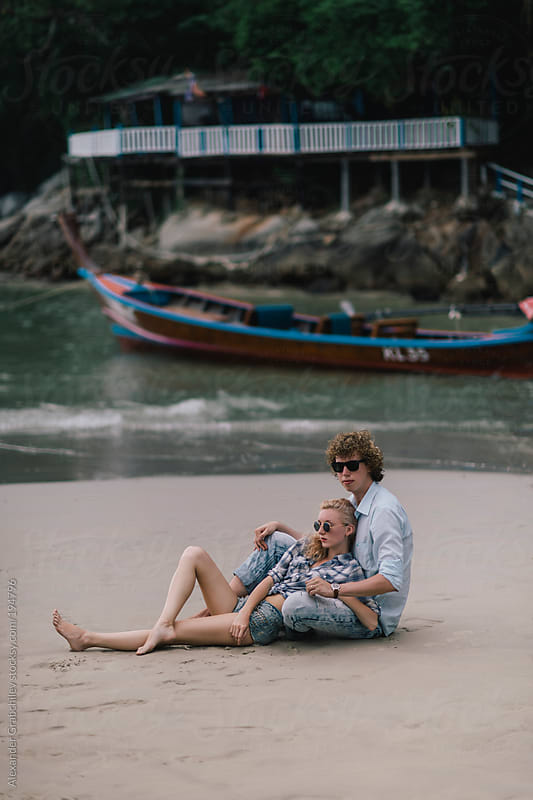 Young Couple In Love At The Sand Beach by Alexander Grabchilev for Stocksy United