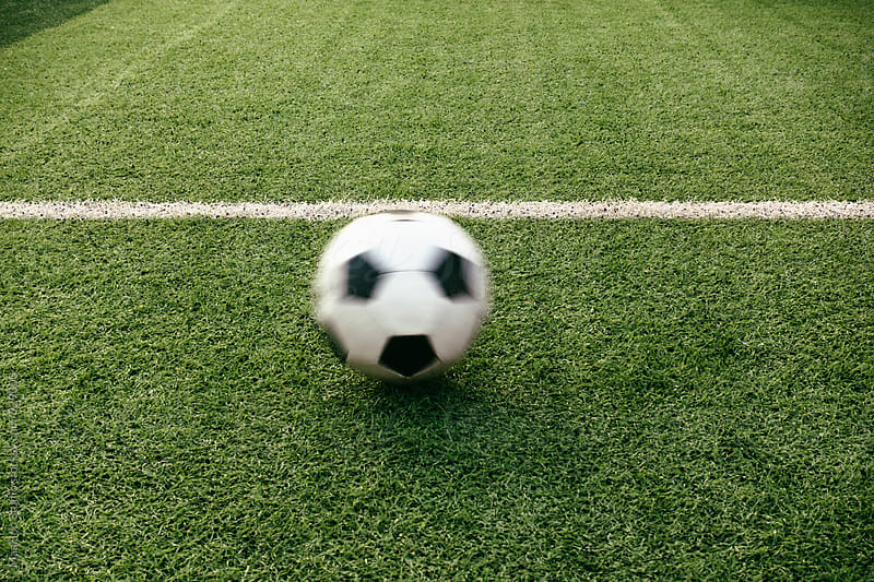 Soccer ball on football field by Maa Hoo for Stocksy United