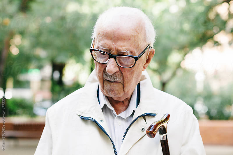 Portrait of an elderly man standing outside. by BONNINSTUDIO for Stocksy United