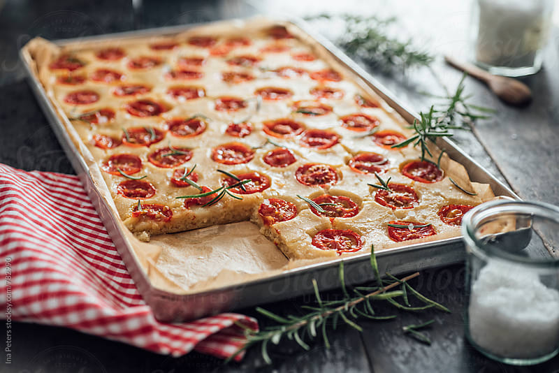 Food: Tamato Focaccia with rosemary by Ina Peters for Stocksy United