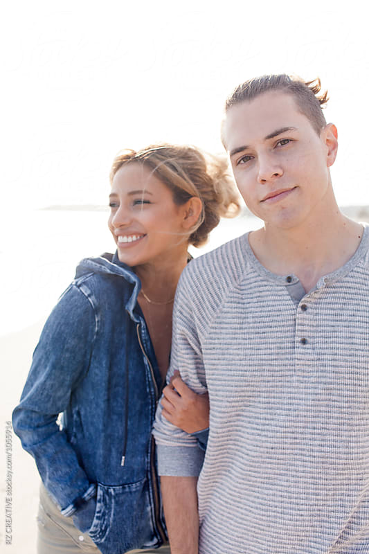 Portrait of young couple at the beach. by Robert Zaleski for Stocksy United