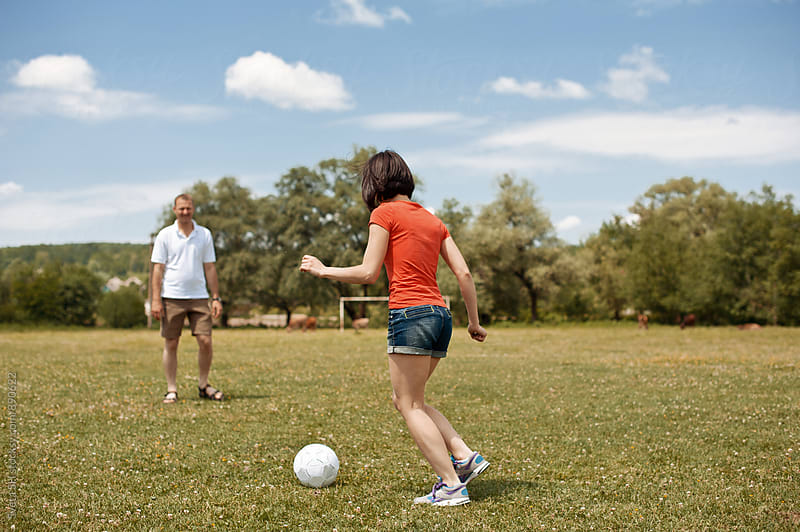 Young man and girl are playing soccer by Sveta SH for Stocksy United