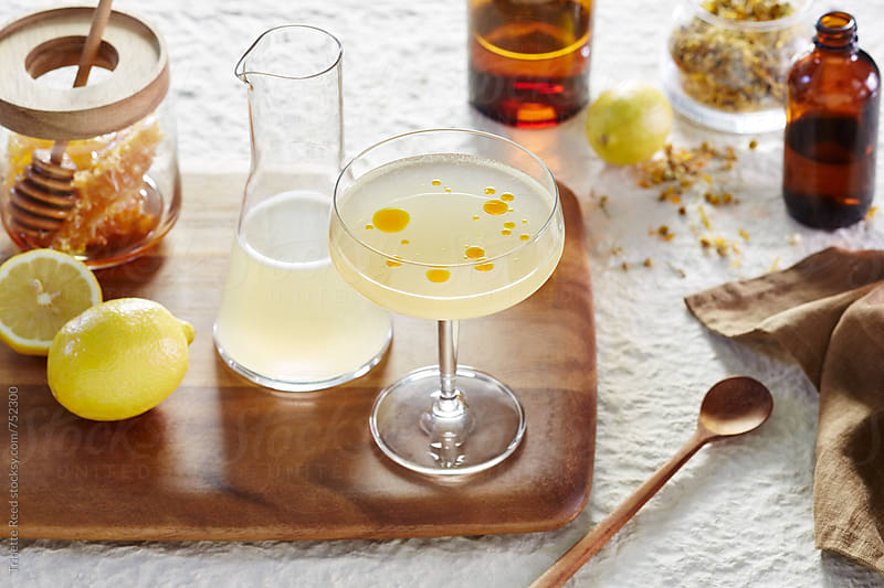 Honey, lemon, chamomile cocktail with chile oil by Trinette Reed for Stocksy United