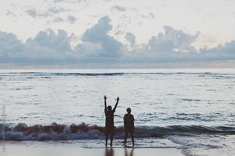Two people watching the ocean by Carey Shaw for Stocksy United