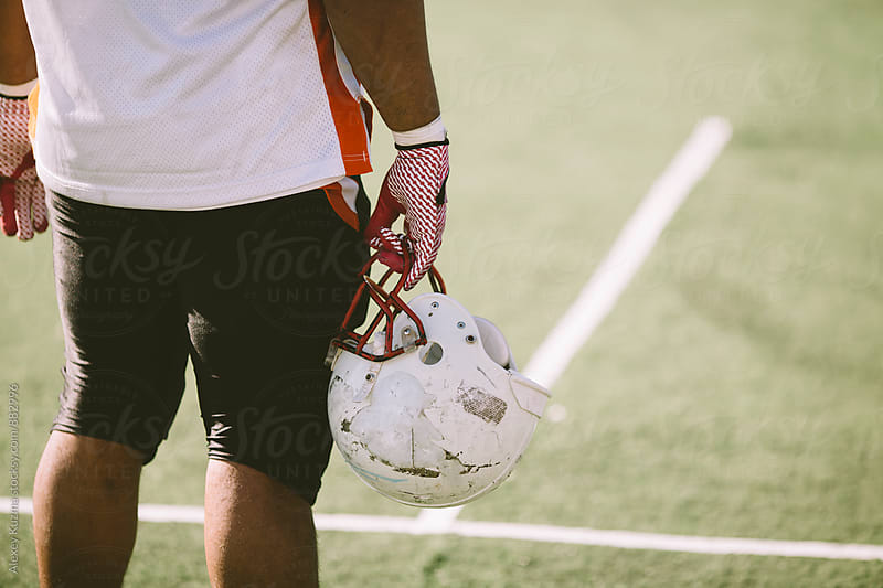 American football player by Alexey Kuzma for Stocksy United