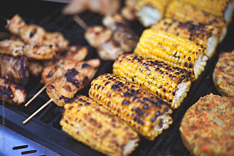 cooking corn on the cob on the Barbecue by Natalie JEFFCOTT for Stocksy United