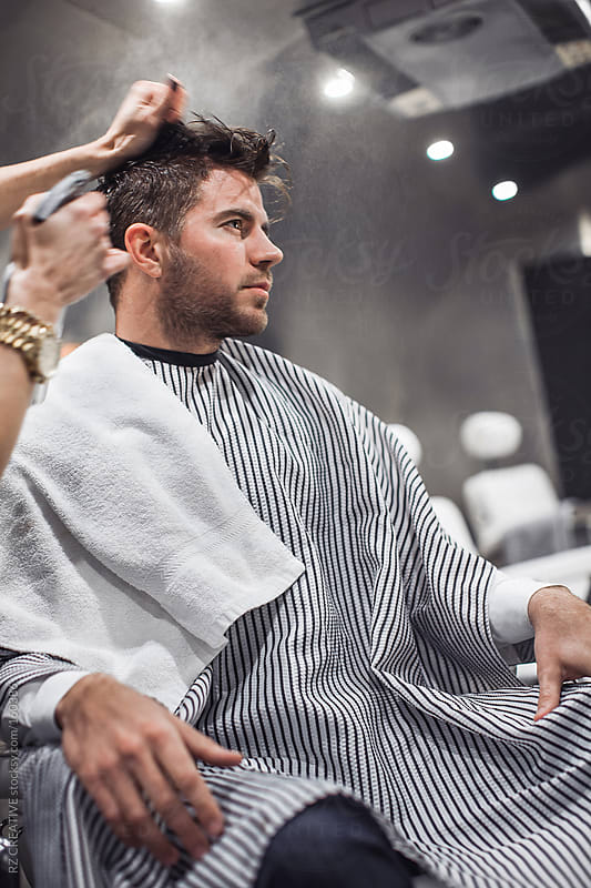 A young man at the barber. by RZ CREATIVE for Stocksy United