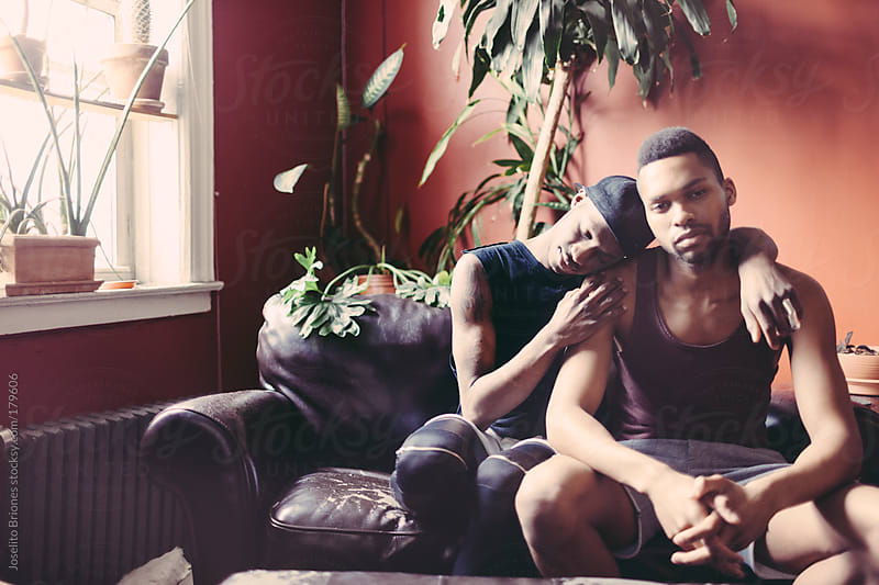 Portrait of Gay Black Men Couple in their Living Room by Joselito Briones for Stocksy United