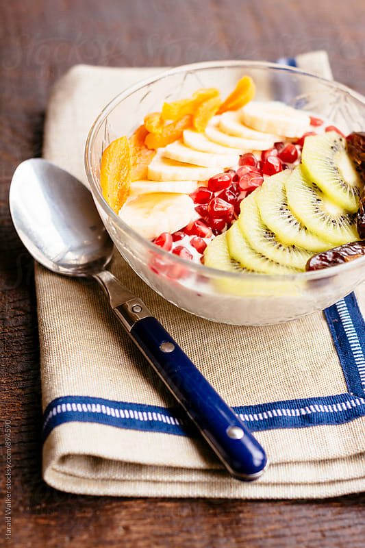 Fruit Smoothie Bowl by Harald Walker for Stocksy United
