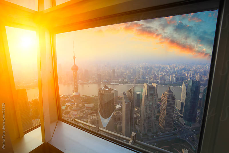 Bird view at Shanghai China. Skyscraper under architectural in foreground.the sunset sky  by Wenhai Tang for Stocksy United
