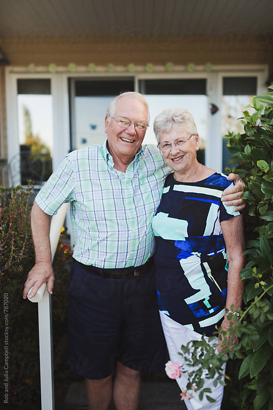 Portrait of happy senior couple outside enjoying life together by Rob and Julia Campbell for Stocksy United