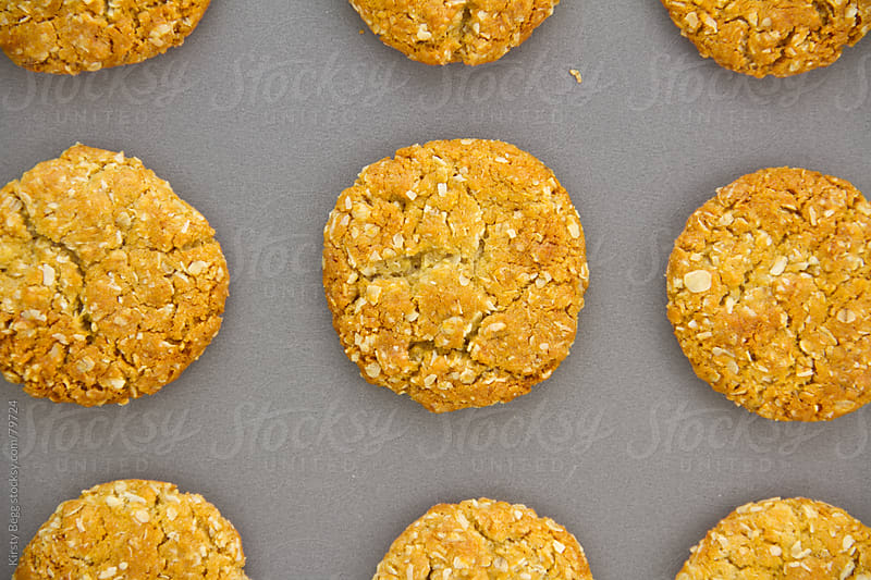 ANZAC biscuits cookie baked on sheet by Kirsty Begg for Stocksy United