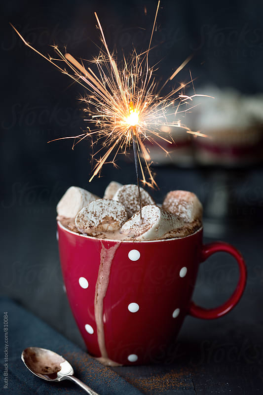 Hot chocolate with marshmallows and sparkler by Ruth Black for Stocksy United