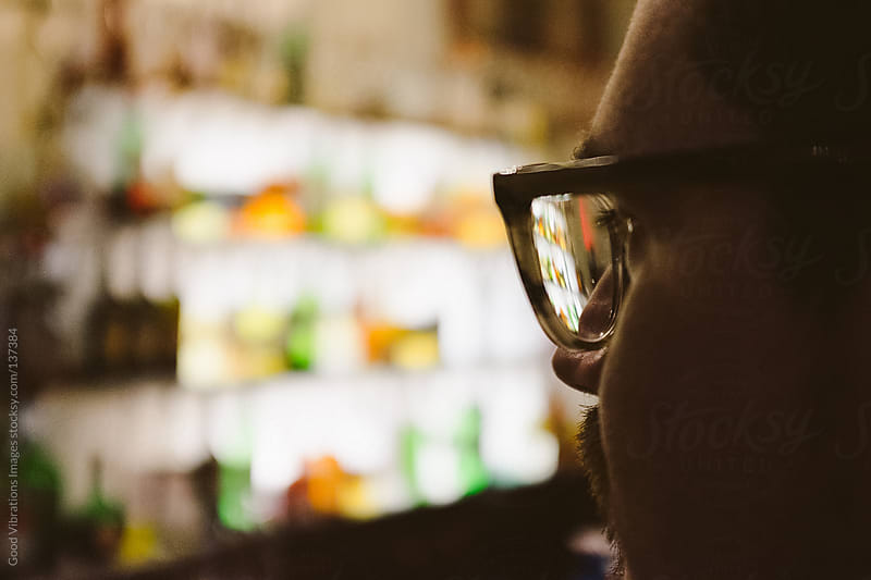 Man in a Bar by Good Vibrations Images for Stocksy United