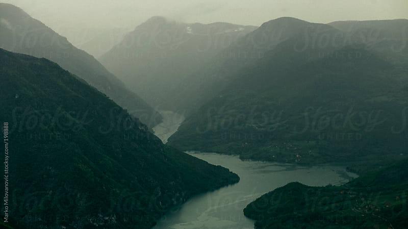 Moody rainy mountain landscape by Marko Milovanović for Stocksy United