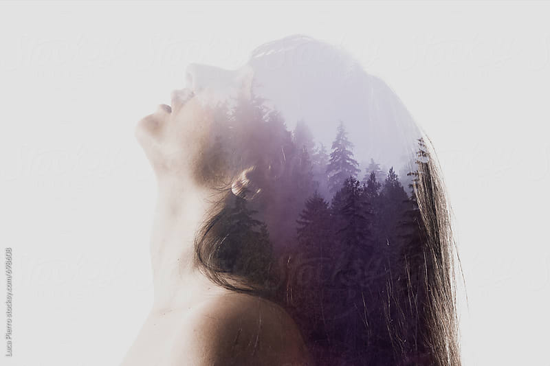 Double exposure/ silhouette of young woman and trees by Luca Pierro for Stocksy United