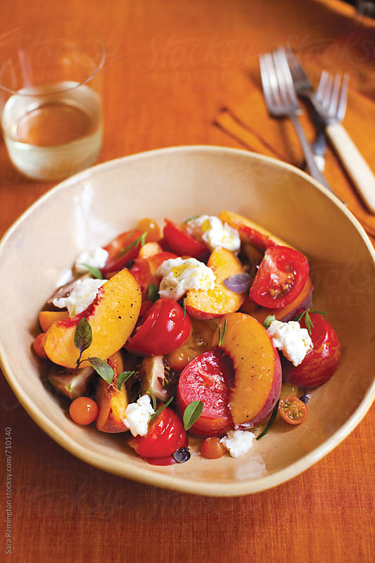 Peach and Tomato Summer Salad by Sara Remington for Stocksy United