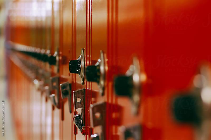 Row of brightly colored school lockers by Kelli Seeger Kim for Stocksy United