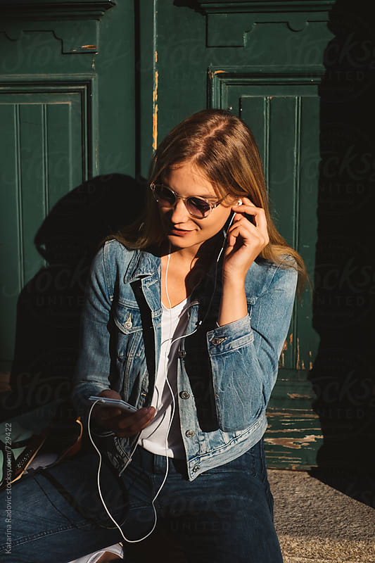 Pretty Blond Woman Listening to Music by Katarina Radovic for Stocksy United