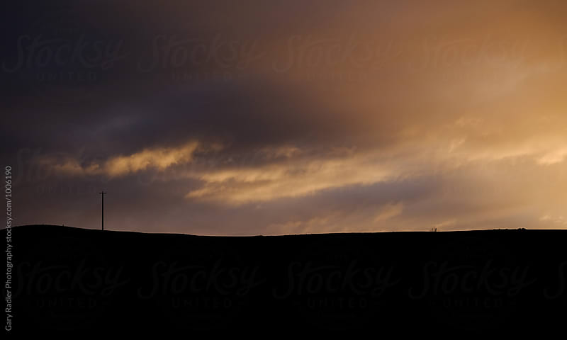 Silhouette of a Power Pole on a Hill by Gary Radler Photography for Stocksy United