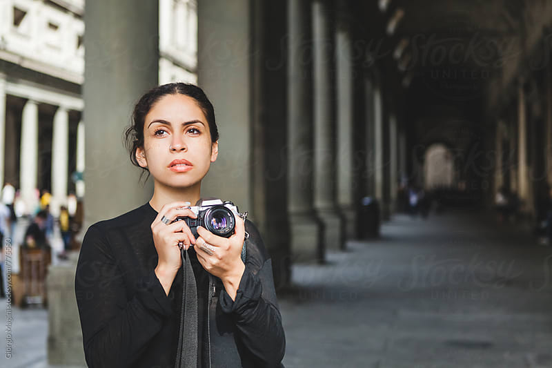 Young Woman Photographing Old Italian Architecture with an Analog Camera by Giorgio Magini for Stocksy United