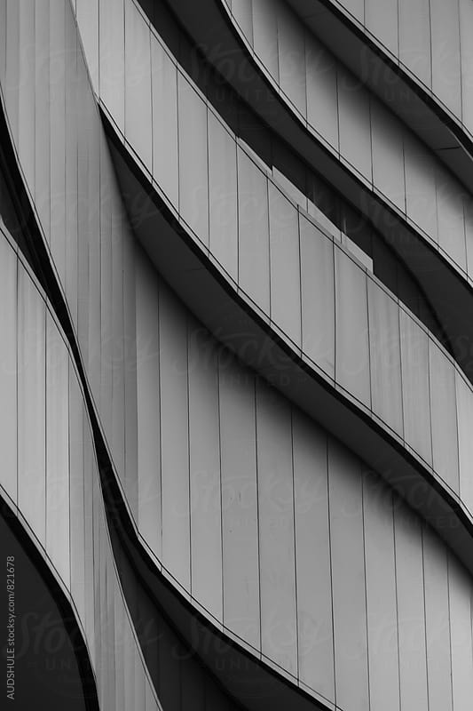 Abstract curved line details on building exterior. by Audrey Shtecinjo for Stocksy United