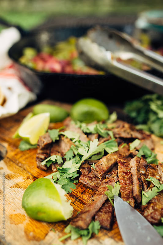 Grilled beef sliced for fajitas by Gabriel (Gabi) Bucataru for Stocksy United