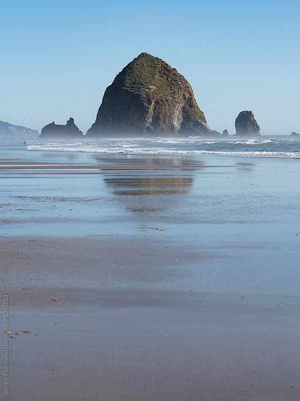 Giant rock in Pacific Ocean water. Cannon Beach, Oregon by Jeremy Pawlowski for Stocksy United