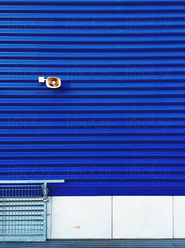 loudspeaker on a blue external wall by Juri Pozzi for Stocksy United