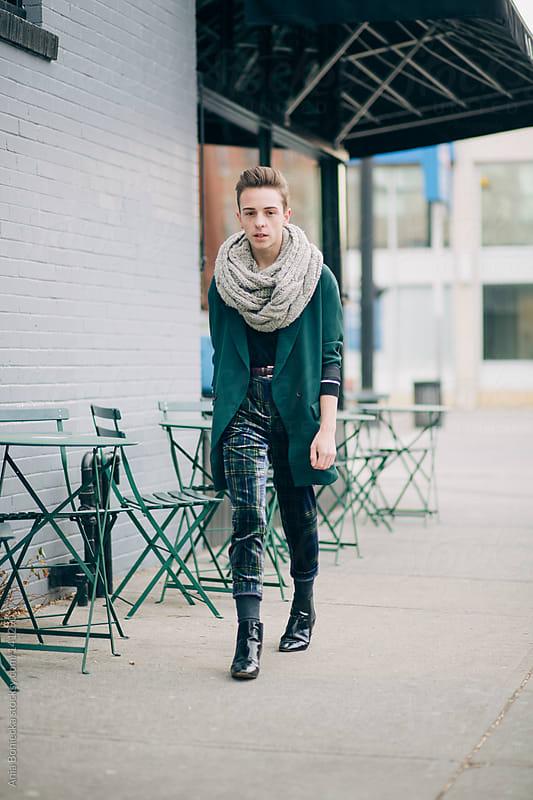 A stylish man walking down the street  by Ania Boniecka for Stocksy United