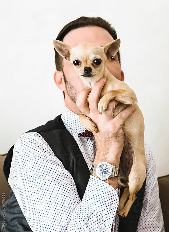 Man portrait with Chihuahua by Simone Becchetti for Stocksy United