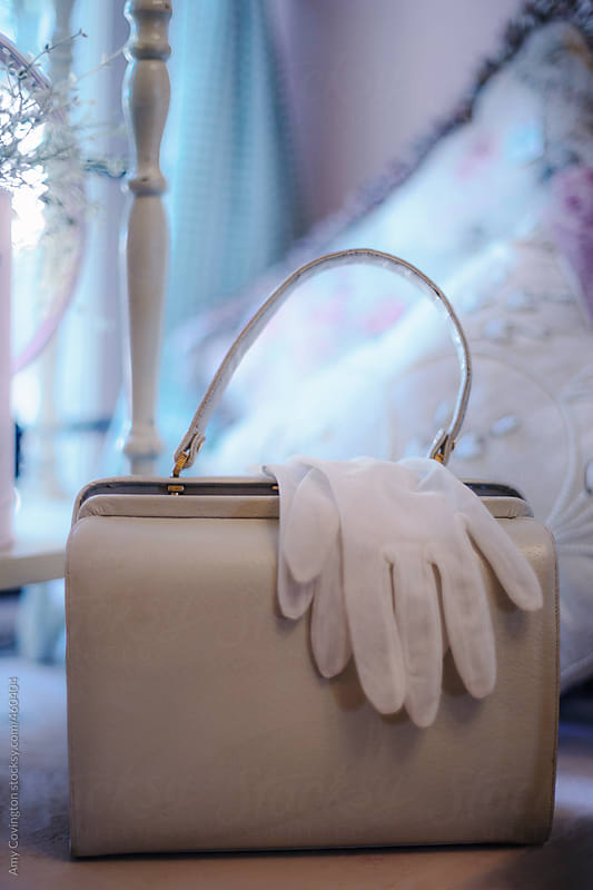Vintage purse and gloves by Amy Covington for Stocksy United
