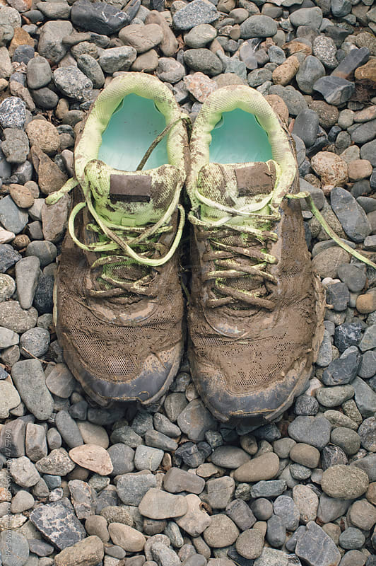 Pair of very dirty runners shoes after exercise by Per Swantesson for Stocksy United