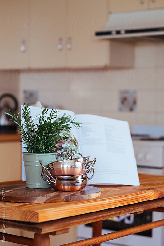Copper food bowls on kitchen bench by Rowena Naylor for Stocksy United