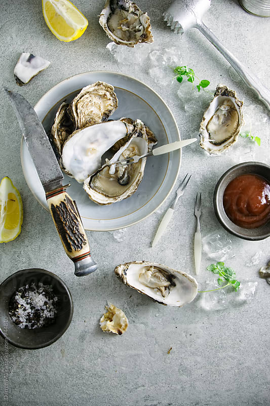 Oyster appetizer.  by Darren Muir for Stocksy United