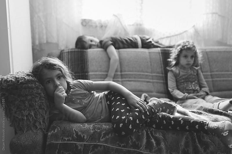 Children watching Tv by Dejan Ristovski for Stocksy United