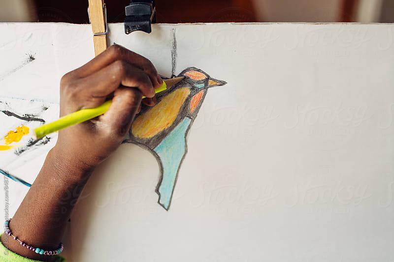Hand of an African American girl drawing a bird by Gabriel (Gabi) Bucataru for Stocksy United