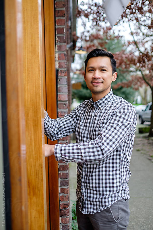 Small business owner opening the door of his store by Suprijono Suharjoto for Stocksy United