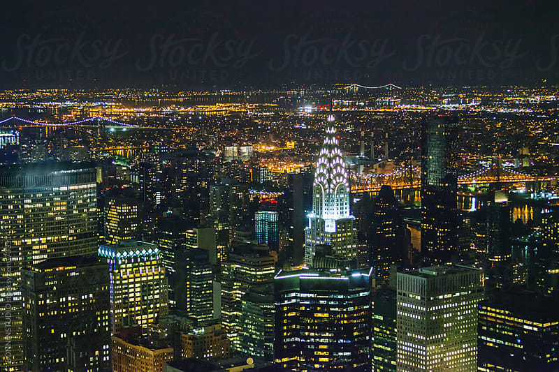 New York skyline at night from Empire State building.  by BONNINSTUDIO for Stocksy United