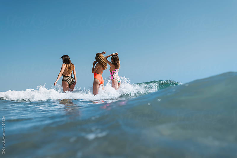 Three girls having fun in the sea by GIC for Stocksy United