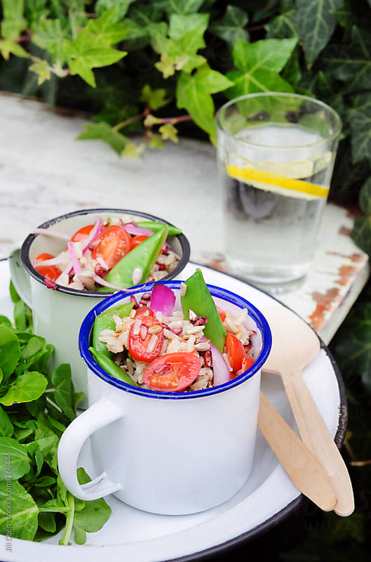 Light healthy lunch rice salad outdoors by Jill Chen for Stocksy United