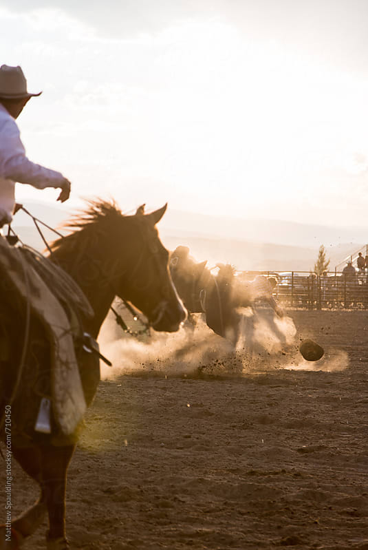 Man falling from horse at rodeo by Matthew Spaulding for Stocksy United