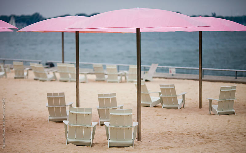 Toronto Beach with Pink Umbrellas by Thomas Hawk for Stocksy United