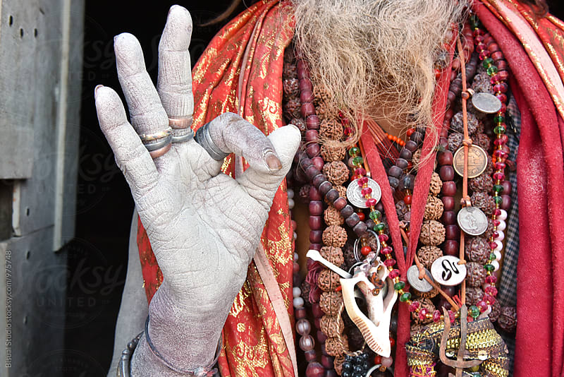 Detail of a sadhu's hand praying on a temple by Bisual Studio for Stocksy United