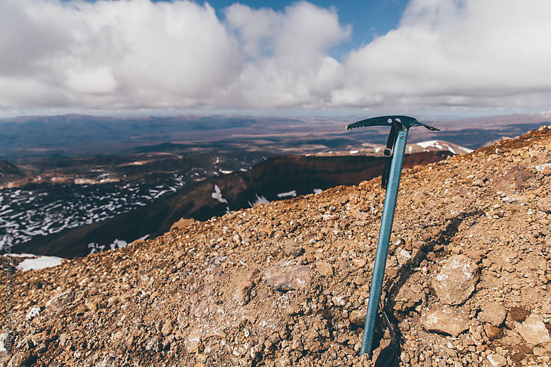 Ice axe on the top of a mount by Andrey Pavlov for Stocksy United